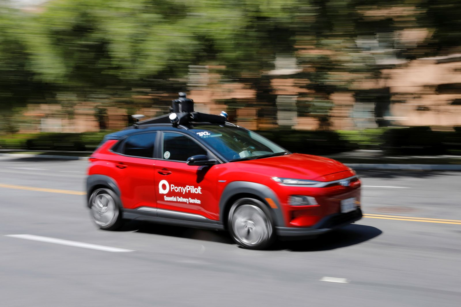 Autonomous electric vehicles deliver packages during the outbreak of the coronavirus disease (COVID-19) in California