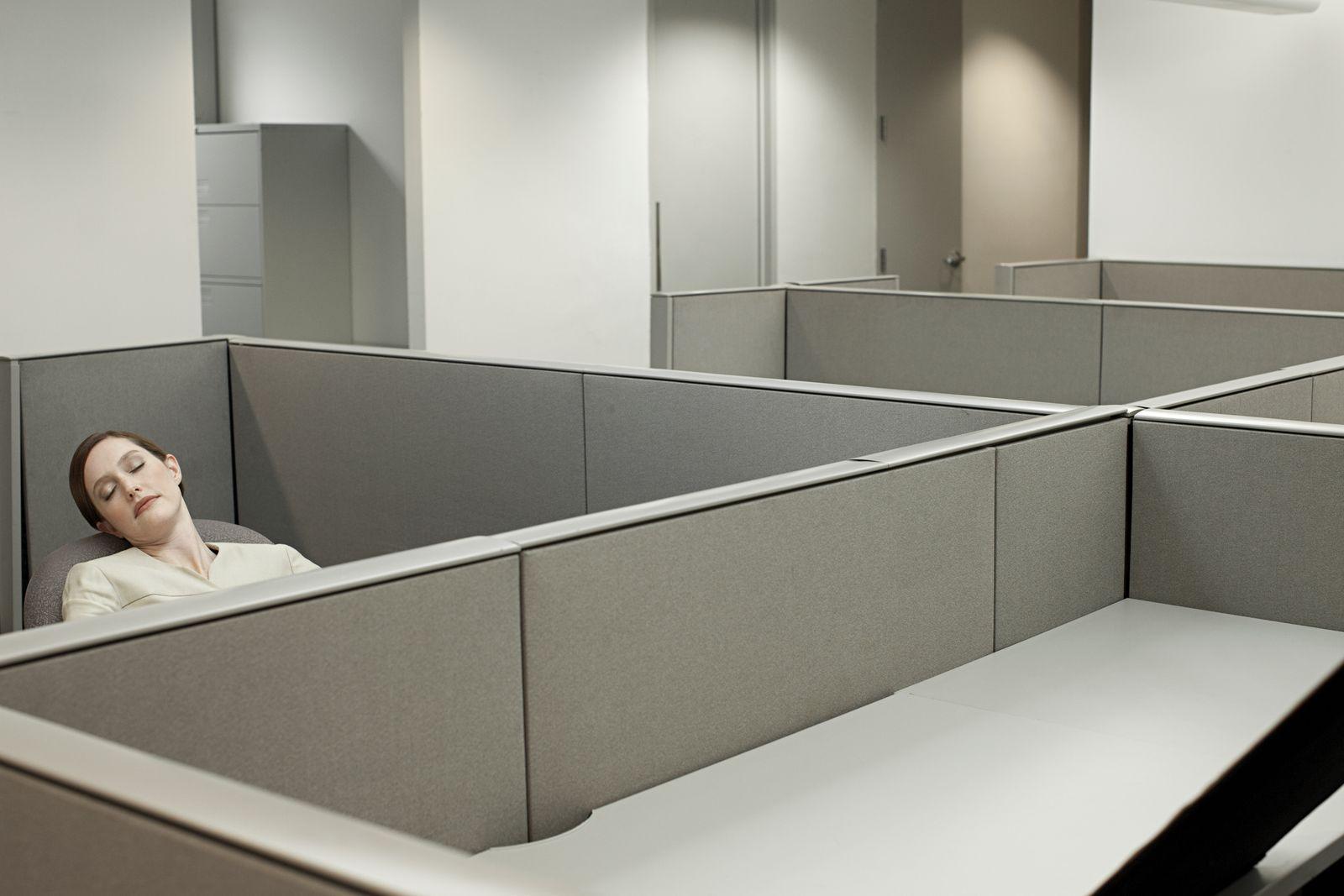 Businesswoman sleeping in empty office