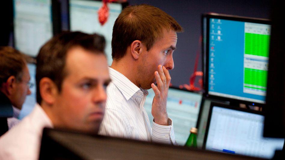 Sorgenvolle Mienen: Die Zahlen zum deutschen Wirtschaftswachstum kamen an der Börse nicht gut an