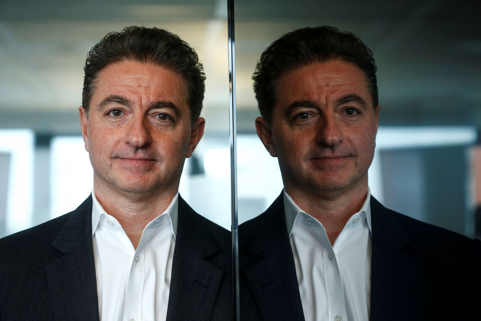 CEO of Deutsche Telekom's T-Systems, Al-Saleh poses prior to an interview with Reuters in Frankfurt
