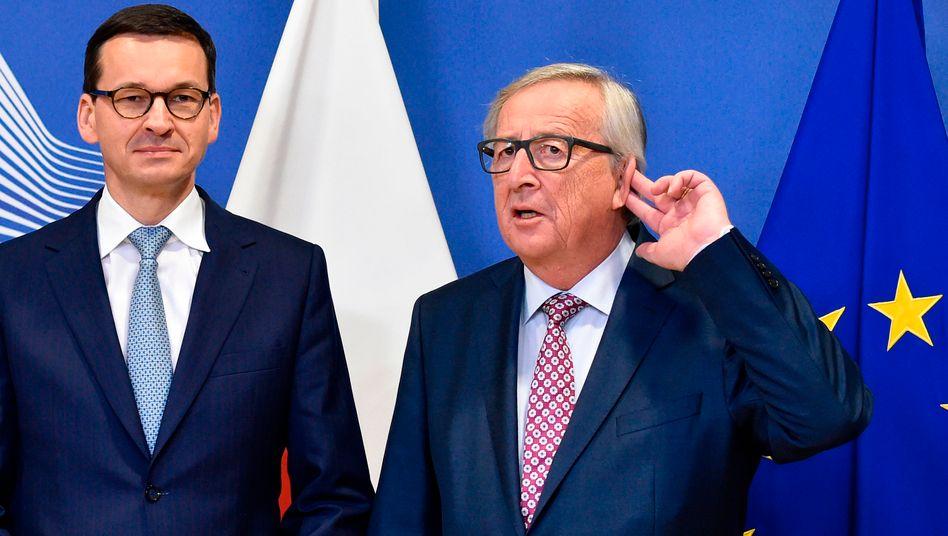 Polens Regierungschef Mateusz Morawiecki, EU-Kommissionschef Juncker: Polen und Ungarn beanspruchen Geld von der EU, halten sich aber nicht an EU-Werte