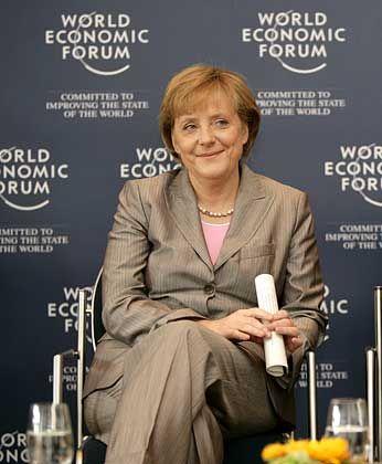 Ehrengast: Bundeskanzlerin Angela Merkel hält die Eröffnungsrede - doch Regierungschefs aus den westlichen Industrienationen machen sich in Davos rar