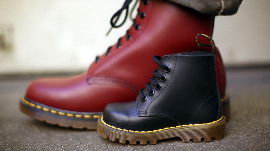 Vom robusten Arbeits- zum weltberühmten Punk-Stiefel: Die Marke Dr. Martens wurde 1960 in Großbritannien gegründet und später in der Skinhead-Szene populär