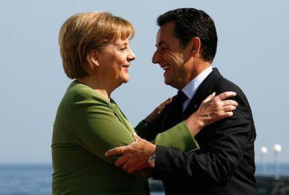 Ringen unter Partnern: Merkel mit Sarkozy