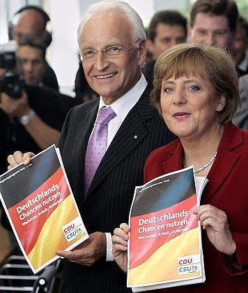 Angela Merkel und Edmund Stoiber mit Wahlprogramm: Milliardenschwere Abschreibungsnummern wie bei Vodafone werden wieder möglich
