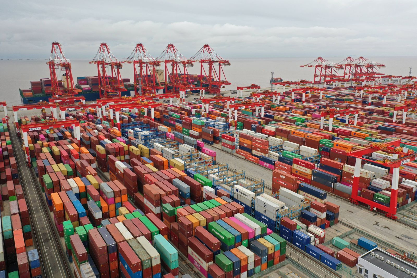 SHANGHAI, CHINA - MAY 19: Aerial view of shipping containers sitting stacked at Yangshan Deepwater Port on May 19, 2021