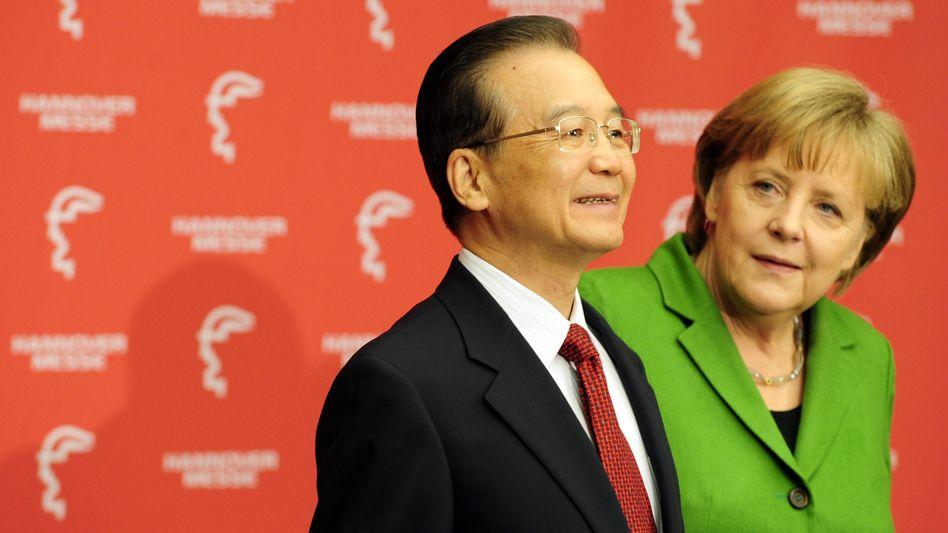 Wen und Merkel: Beide wollen die industrielle Zusammenarbeit verstärken