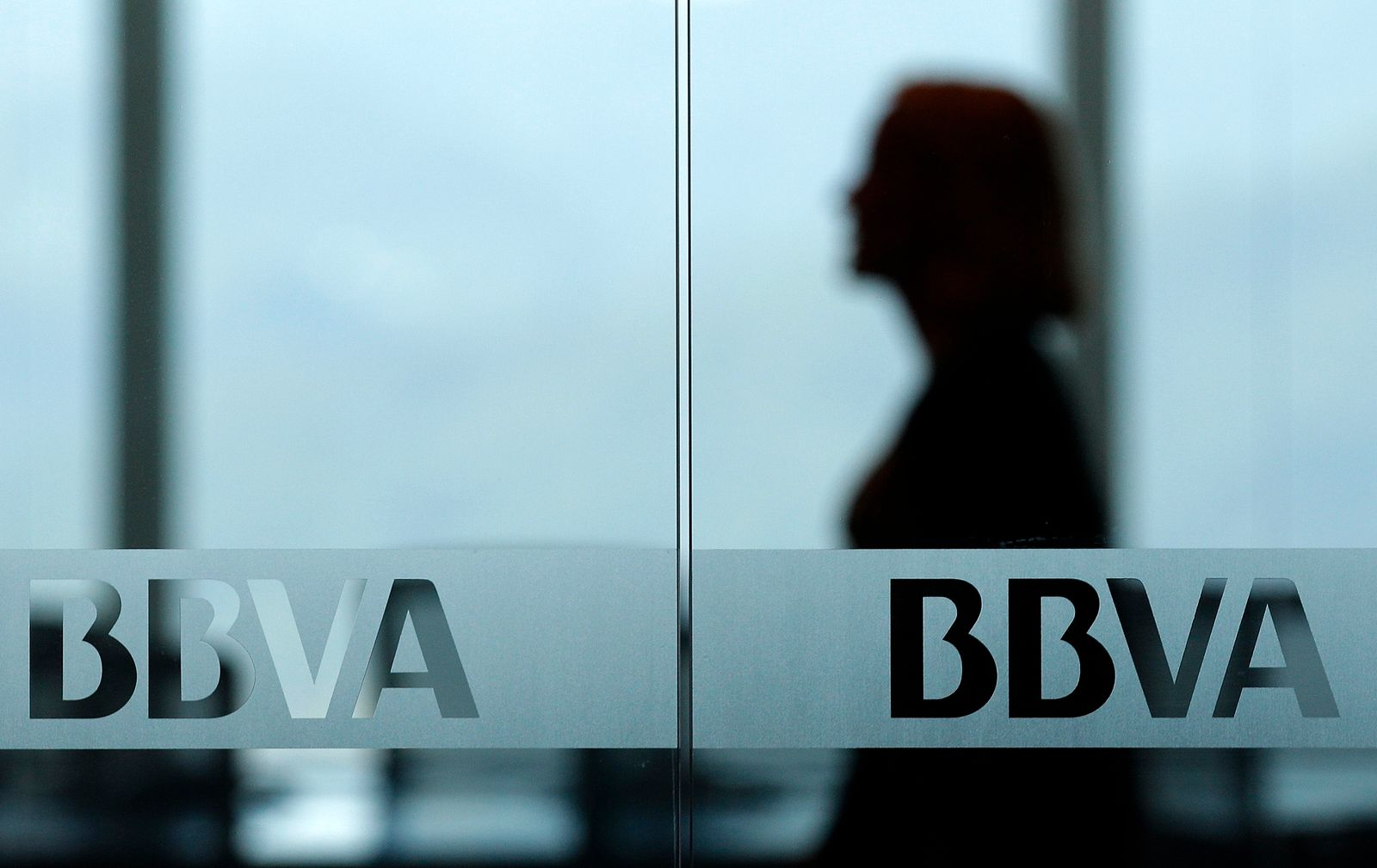 An employee walks in the newly opened office of Banco Bilbao Vizcaya Argentaria (BBVA) at the Taipei 101 building