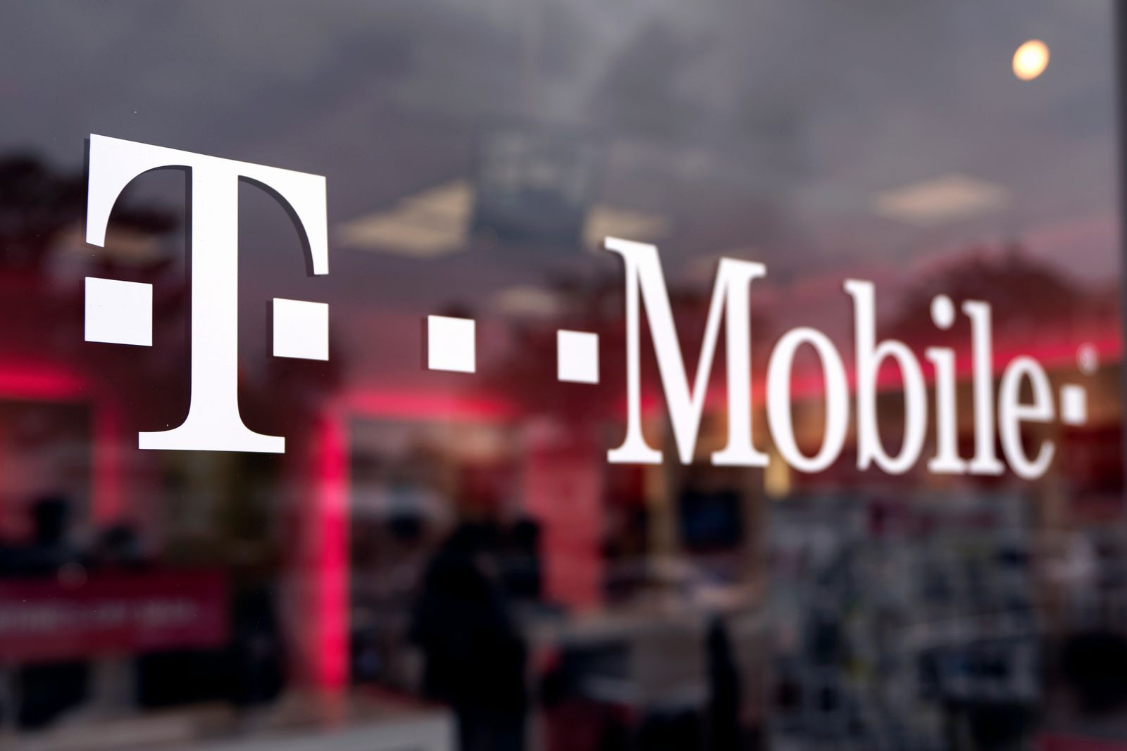 A T-Mobile logo is seen displayed on a store in Los Angeles