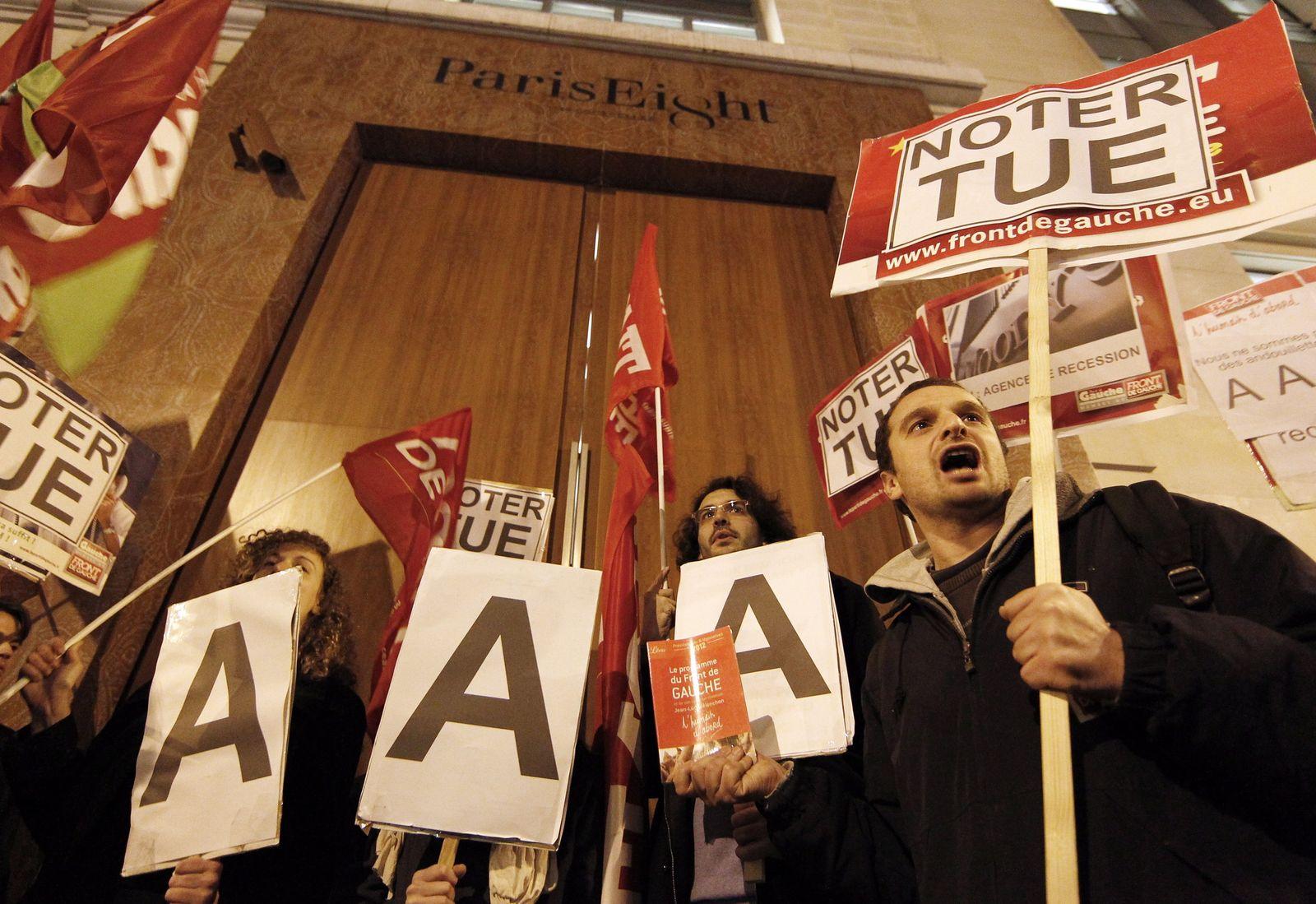 Left wing members demonstrate in front of Standard & Poors locat