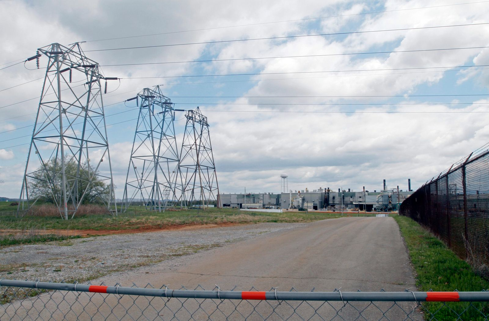 Power lines and large buildings are shown in the view of the Alcoa Aluminium plant