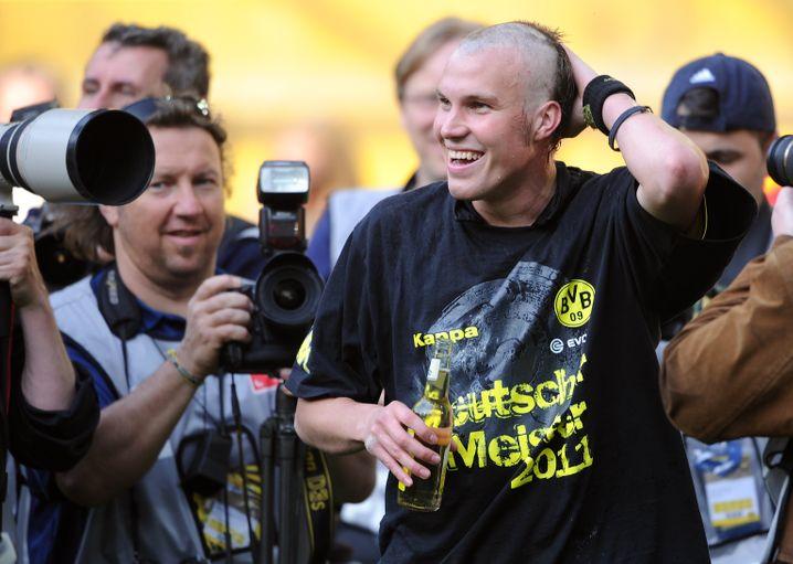 Botschaft nach Bayern? Nach dem Gewinn der Meisterschaft 2011 überraschte BVB-Mann Großkreutz mit einer Eigenhaaramputation