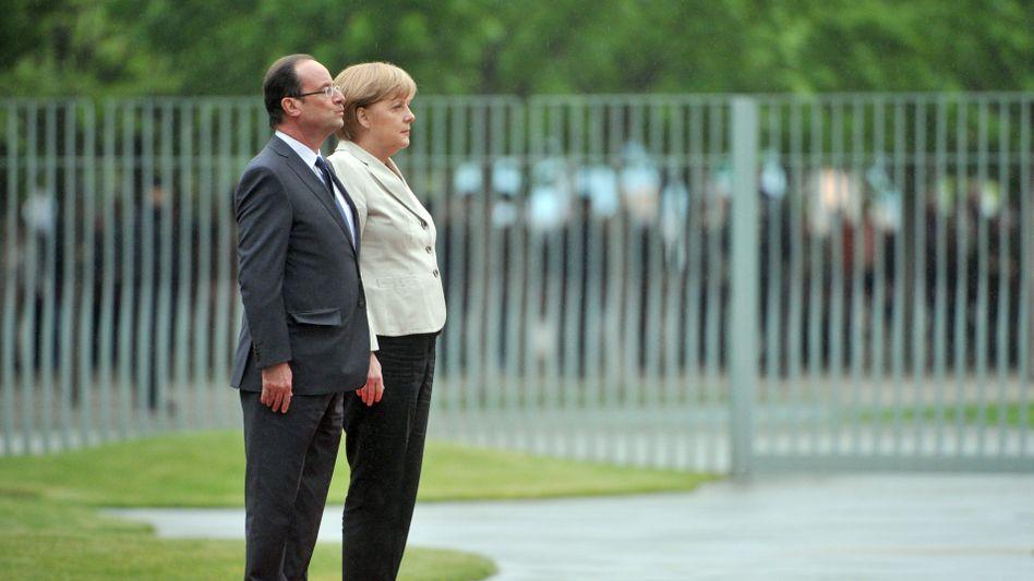 Hollande und Merkel: Sie stemmen sich gegen die Krise