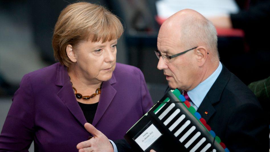 Bundeskanzlerin Merkel und Fraktionsvorsitzender Kauder: Unterschiedliche Ansichten über den Mindestlohn