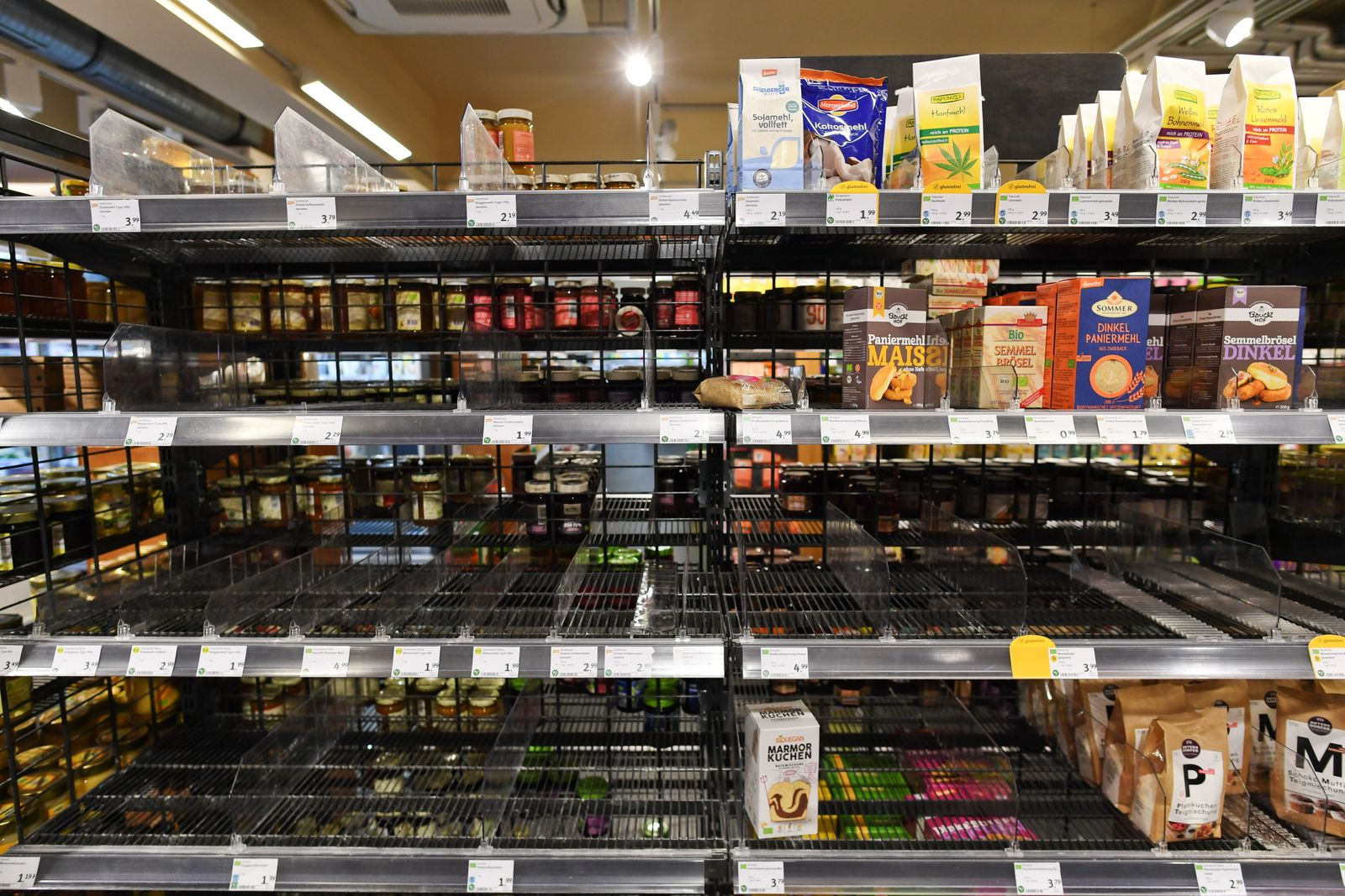 Partially emptied shelves are pictured in a supermarket in Munich