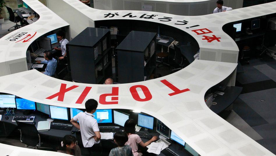 Händler an der Tokyo Stock Exchange (TSE): Fusion zur drittgrößen Börse der Welt