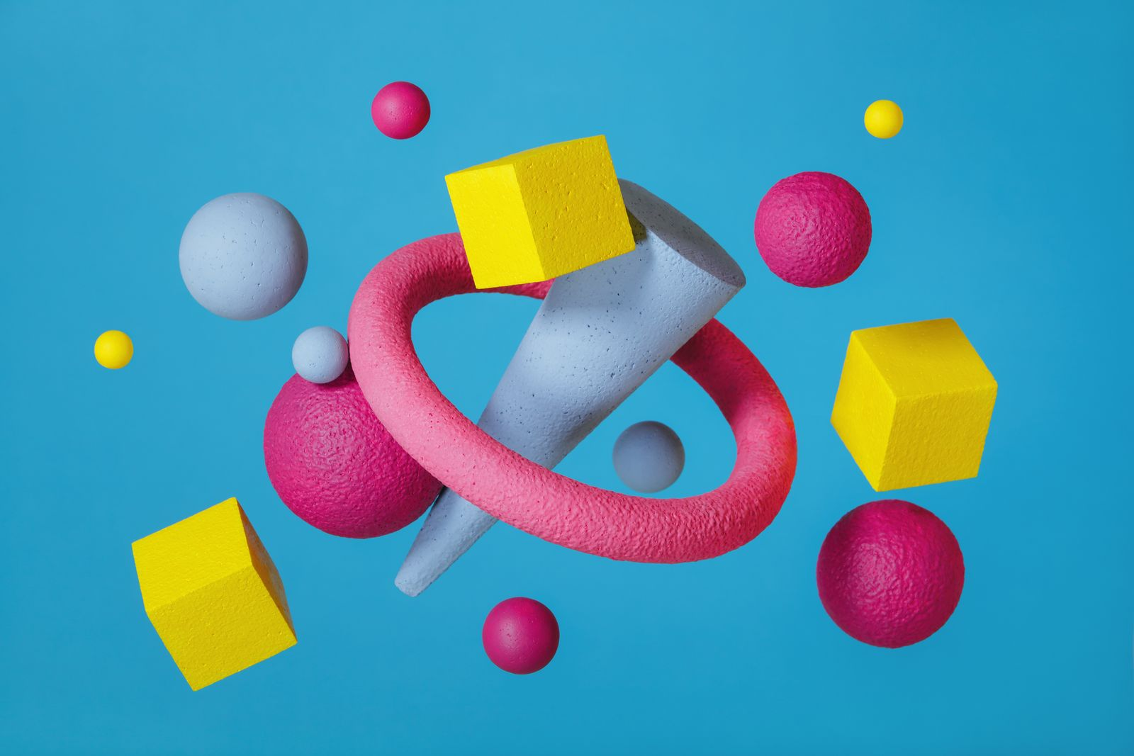 Abstract multi-colored objects on blue background