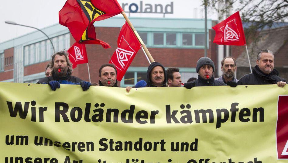 Protest: Mitarbeiter der insolventen Manroland demonstrierten Ende November für den Erhalt ihrer Jobs. Die Allianz als Mehrheitseigentümer hatte entschieden, in das Unternehmen keinen Cent mehr zu investieren