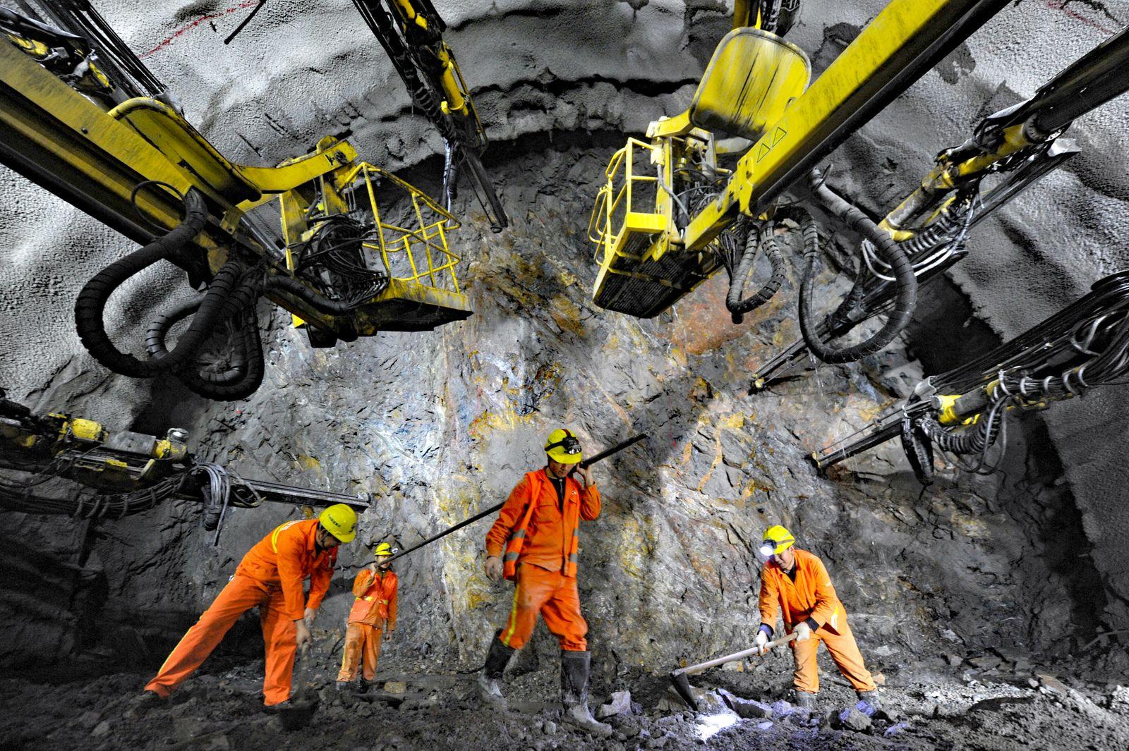 Workers are seen in a tunnel for the Beijing-Zhangjiakou high speed railway under construction in Beijing