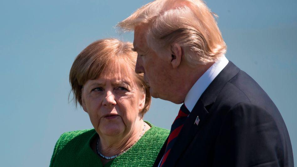 """Merkel, Trump (beim G7-Gipfel während Trumps Kurzbesuch): Offen für Null-Zoll-Lösung - doch es muss eine """"umfassende Industrielösung"""" sein"""